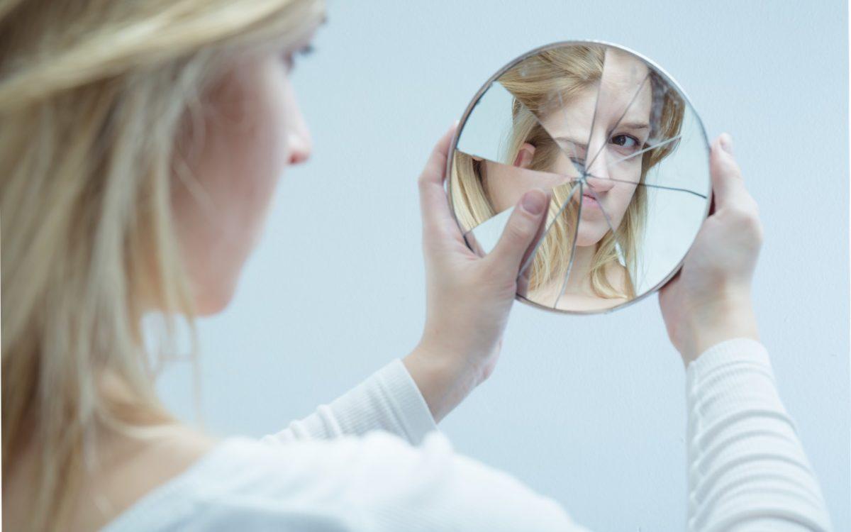 woman broken mirror self
