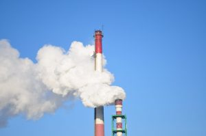 smoke stacks against blue sky